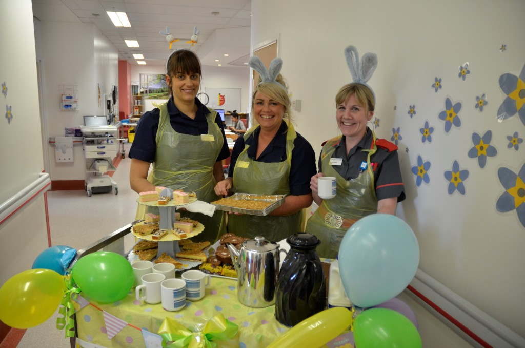 Lead nurses Leanne Mann and Sarah Causer serve tea and cakes to patients on Ward C3 with matron Rachel Tomkins
